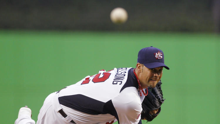 United States' Ryan Vogelsong delivers a pitch during the first inning of the second-round elimination game of the World Baseball Classic against Puerto Rico, Friday, March 15, 2013 in Miami. (AP Photo/Andrew Innerarity, Pool)