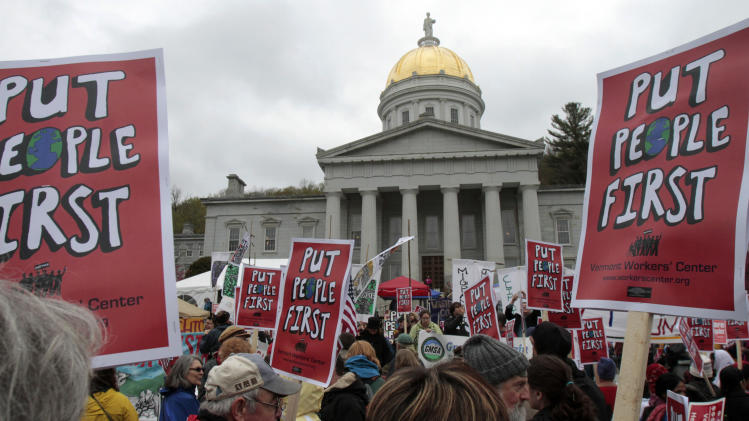 People rally at the Statehouse during a May Day protest on Tuesday, May 1, 2012 in Montpelier, Vt. The most visible organizing effort by anti-Wall Street groups since Occupy encampments were dismantled last fall were planned for May Day. From New York to San Francisco, organizers of the various demonstrations, strikes and acts of civil disobedience said they are not too concerned about muddling the message, noting that the movements have similar goals: jobs, fair wages and equality. (AP Photo/Toby Talbot)