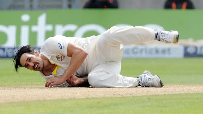Australia's Mitchell Johnson falls while bowling during day two of the third Ashes Test cricket match, at Edgbaston, Birmingham, England, Thursday, July 30, 2015. (AP Photo/Rui Vieira)