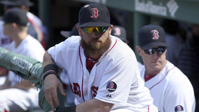 Boston Red Sox Gomes prepares in the dugout before facing the Toronto Blue Jays in their MLB American League East baseball game in Boston