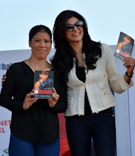 Olympic medal-winning boxer M.C. Mary Kom with actress Sushmita Sen during the launch of `UNBREAKABLE` autobiography of the boxer which was released at IIT Guwahati on Dec.16, 2013. (Photo: IANS)