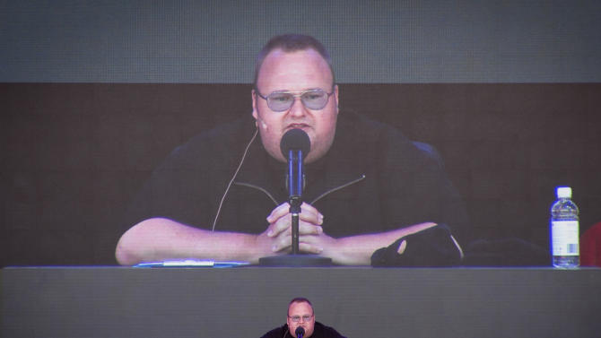 """FILE - In this Jan. 20, 2013 file photo, Megaupload founder Kim Dotcom practices a speech before the launch of a new file-sharing website called """"Mega"""" at his Coatesville mansion in Auckland, New Zealand. Dotcom said Thursday, June 20, 2013 he was """"in tears"""" after a European company deleted all the data it was hosting from his shuttered file-sharing site. Netherlands-based LeaseWeb announced it had deleted all Megaupload files from 630 servers. (AP Photo/New Zealand Herald, Richard Robinson, File) NEW ZEALAND OUT, AUSTRALIA OUT"""