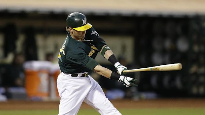 Moss hits winning HR in 9th, A's beat Mariners