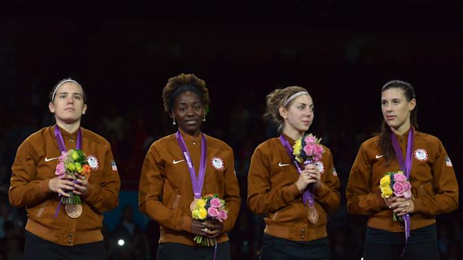 Team USA celebrates with the bronze meda