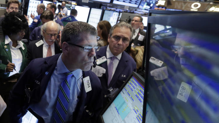Trader Sean Spain is reflected in a screen at a post the floor of the New York Stock Exchange Thursday, April 11, 2013.  Stock indexes are little changed in early trading on Wall Street after three days of gains. (AP Photo/Richard Drew)