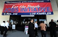 <p>Job seekers arrive at an outdoor job fair in Los Angeles in 2011. The US economy created a solid 163,000 jobs in July, the Labor Department said Friday, unveiling data that will help President Barack Obama dull attacks from his Republican election rival.</p>