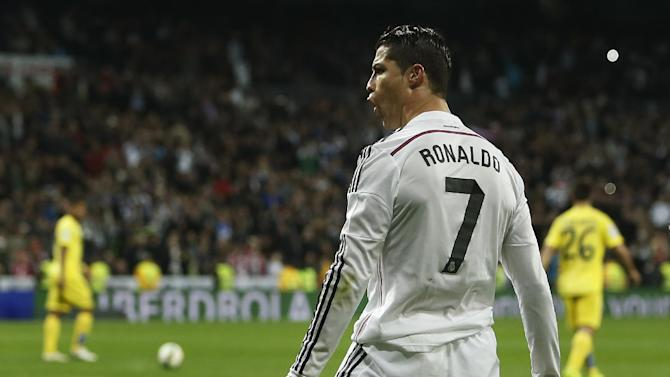Real Madrid's Cristiano Ronaldo, celebrates his goal during a Spanish La Liga soccer match between Real Madrid and Villarreal at the Santiago Bernabeu stadium in Madrid, Spain, Sunday, March 1, 2015. (AP Photo/Andres Kudacki)