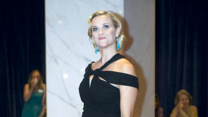 """FILE - In this April 28, 2012, file photo, Reese Witherspoon arrives at the White House Correspondents Association dinner in Washington. It will be Sarah Jessica Parker's house, but President Barack Obama's show. You could call it """"Checks and the City."""" Needing to boost his donor base and campaign cash, Obama is banking on elite entertainers for help so often they have essentially become a cast of characters in his campaign. He is using his Hollywood access and raffling it off as a prize to others, tapping into a nation that revels in celebrity even in hard economic times. From Tinseltown to Broadway, Obama has surrounded himself with blockbuster names lately: George Clooney, Julia Roberts, Witherspoon, Spike Lee, Will Smith, Oprah Winfrey, Ellen DeGeneres, Cher and many others who make more in one year that most people do in a lifetime. (AP Photo/Kevin Wolf, File)"""