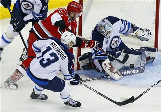 Ladd's OT goal lifts Jets past Hurricanes, 4-3