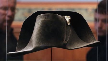 Transport staff members prepare to pack the two-cornered hat worn by French Emperor Napoleon during the Battle of Waterloo at the Museum of Sens