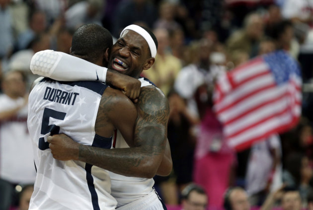 United States' LeBron James and Kevin Durant react during the men's gold medal basketball game against Spain at the 2012 Summer Olympics, Sunday, Aug. 12, 2012, in London. USA won 107-100. (AP Photo/C