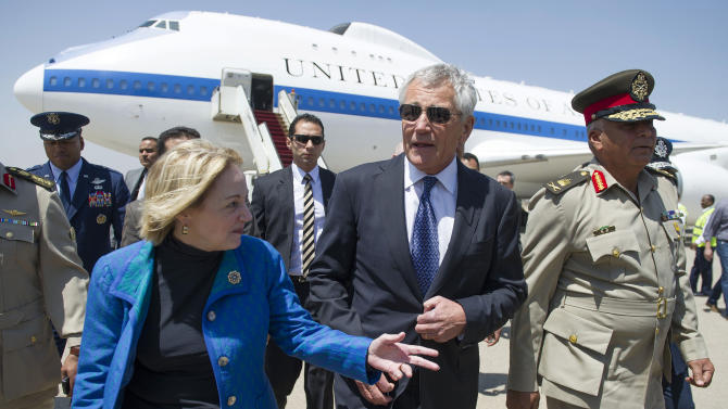 """FILE - In this Wednesday, April 24, 2013 file photo, U.S. Secretary of Defense Chuck Hagel speaks with U.S. Ambassador to Egypt Anne Patterson, left, upon his arrival in Cairo. Egyptian anti-government activists have expressed outrage Friday, June 21, 2013 over a statement by the U.S. ambassador in Cairo in which she criticized street protests as opposition gears up for mass rallies to demand the ouster of President Mohammed Morsi. The ambassador, Anne Patterson, said in a speech earlier this week that she is """"deeply skeptical"""" that protests will be fruitful, saying """"more violence on the streets will do little more than add new names to the lists of martyrs."""" (AP Photo/Jim Watson, Pool, File)"""