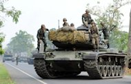 Thai military tanks prepare to patrol near the Thai-Cambodian border in 2011. Thai forces shot dead 38 Cambodians in the first half of this year for illegally crossing the border to log for valuable timber, according to the Cambodian authorities