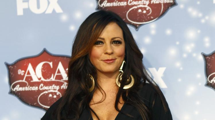 Singer Sara Evans poses as she arrives at the 4th annual American Country Awards in Las Vegas