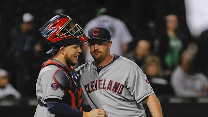 Cleveland Indians relief pitcher Bryan Shaw, right, and Cleveland Indians catcher Roberto Perez celebrate beating the Chicago White Sox 5-2 at the end of a baseball game in Chicago on Thursday, May 21, 2015. (AP Photo/Matt Marton)