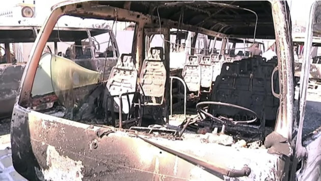 This image made from video released by UNSMIS, the UN observer mission in Syria and accessed Saturday, June 9, 2012, purports to show destroyed buses after overnight fighting in Damascus, Syria. In Da