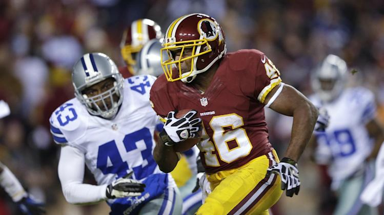 Washington Redskins running back Alfred Morris (46) outruns Dallas Cowboys free safety Gerald Sensabaugh (43) for a touchdown during the first half of an NFL football game Sunday, Dec. 30, 2012, in Landover, Md. (AP Photo/Evan Vucci)