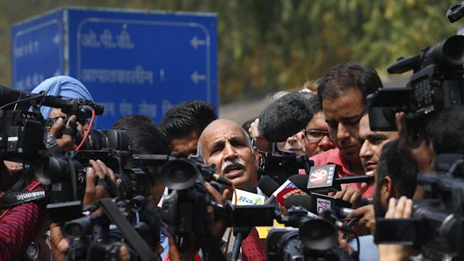 V.K. Anand, lawyer of Ram Singh, a man on trial for the gang rape and fatal beating of a 23-year-old student aboard a New Delhi bus addresses the media outside a hospital in New Delhi, India, Monday, March 11, 2013. Singh committed suicide in an Indian jail Monday, police said, but his lawyer and family allege he was killed. (AP Photo/Saurabh Das)