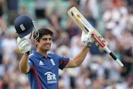 England one-day captain Alastair Cook celebrates reaching his century during the second one-day international (ODI) between England and the West Indies at The Oval in south London on June 19. Cook refused to get carried away after his latest limited overs hundred sealed a series win over the West Indies