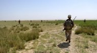 US soldiers on a joint patrol with their Afghan counterparts in Helmand province earlier this year. Seven international soldiers have been killed by their local colleagues in a bloody week of violence in Afghanistan, further eroding trust between foreign troops and the Afghans they work with