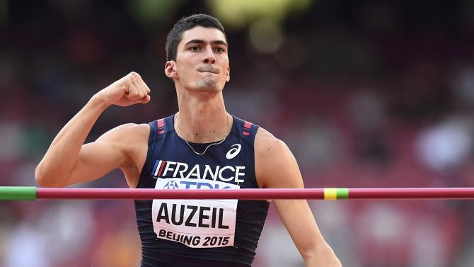 Auzeil of France reacts as he competes in the high jump event of the men's decathlon during the 15th IAAF World Championships at the National Stadium in Beijing