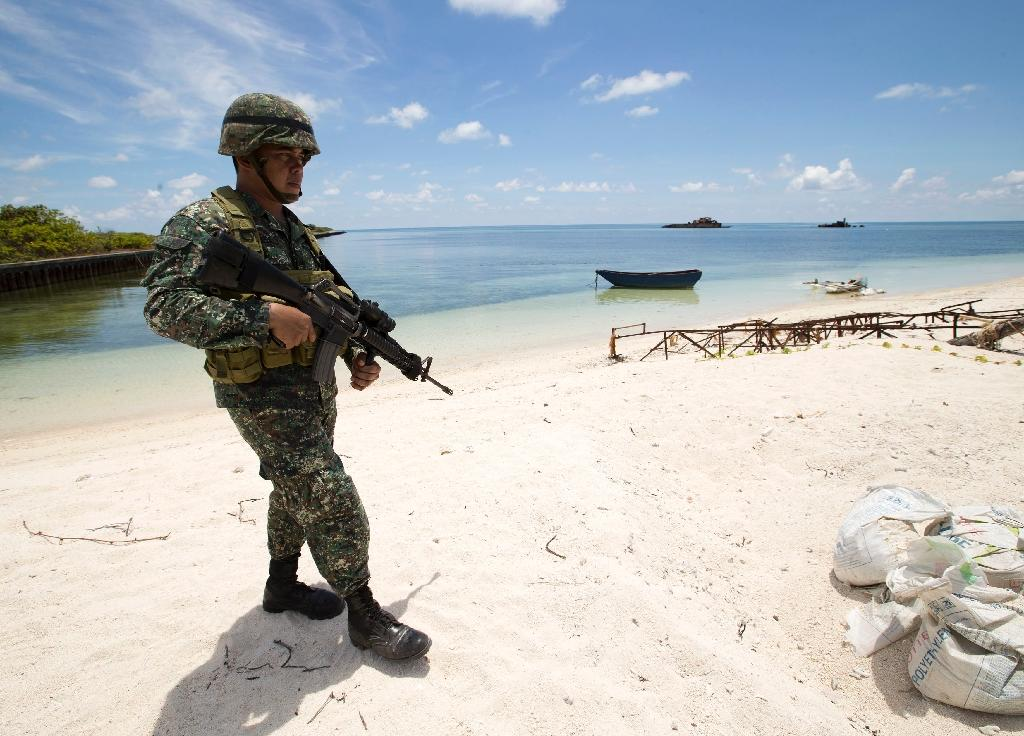 Philippine, Vietnam troops play sports on disputed island