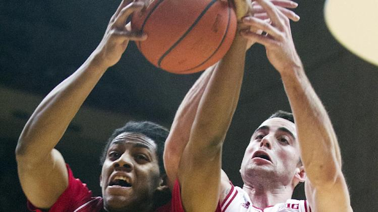 Nebraska's David Rivers (2) grabs a rebound against Indiana's Will Sheehey (0) during the first half of an NCAA college basketball game, Wednesday, Feb. 13, 2013, in Bloomington, Ind. (AP Photo/Doug McSchooler)