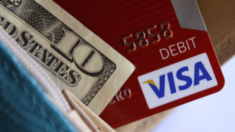 In this photo taken Tuesday, May 3, 2011, a Visa card is displayed with a wallet in Richardson, Texas. Visa Inc., reports quarterly financial earnings Thursday, May 5, after the market close. (AP Photo/LM Otero)
