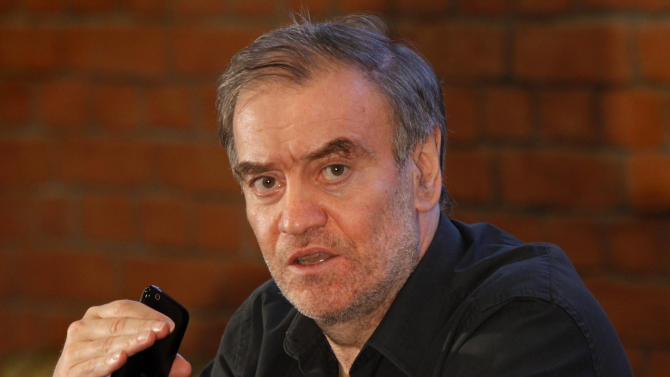 "FILE - In this photo taken Sept. 15, 2010, conductor Valery Gergiev gestures at a news conference in the theater in St. Petersburg, Russia. Gergiev canceled his performance of ""Boris Godunov"" at the Metropolitan Opera on Wednesday, march 9, 2011, and was replaced by Pavel Smelkov. The Met said in a statement that Gergiev was ""suffering from exhaustion and resting in St. Petersburg."" (AP Photo/Dmitry Lovetsky, file)"
