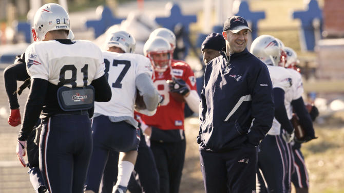New England Patriots offensive coordinator, quarterbacks coach and newly named Penn State head coach Scott O'Brien smiles during practice at the Patriots training facility in Foxborough, Mass. Tuesday, Jan. 10, 2012. (AP Photo/Winslow Townson)