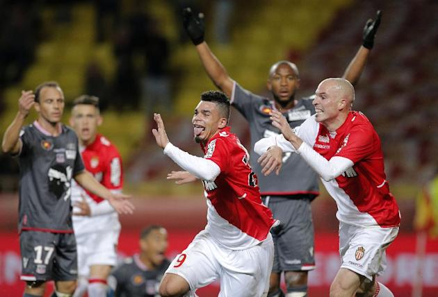 Monaco's Emmanuel Riviere of France, center, celebrates scoring with teammate Andrea Raggi of Italy during their French League One soccer match against Ajaccio in Monaco stadium, Sunday, Dec. 8, 2
