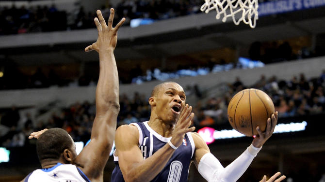 Oklahoma City Thunder guard Russell Westbrook (0) drives around Dallas Mavericks forward Elton Brand (42) during the first half of an NBA basketball game, Friday, Jan. 18, 2013, in Dallas. (AP Photo/Matt Strasen)