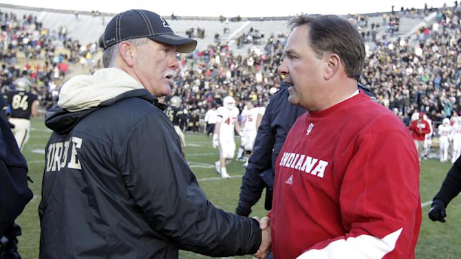 Purdue head coach Danny Hope, left, meets with Indiana head coach Kevin Wilson following an NCAA college football game in West Lafayette, Ind., Saturday, Nov. 24, 2012. Purdue defeated Indiana 56-35. (AP Photo/Michael Conroy)