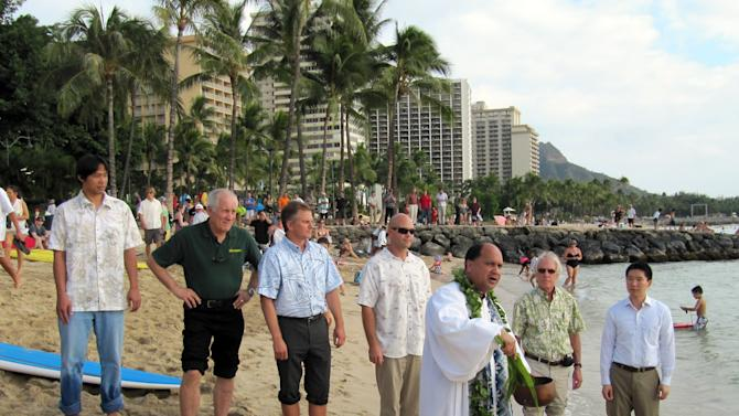 Kahu Kordell Kekoa, front, performs a blessing at Waikiki beach in Honolulu for the start of a $2.3 million project to replenish the sand along a stretch of the shoreline, Wednesday, Jan. 4, 2012. (AP Photo/Audrey McAvoy)