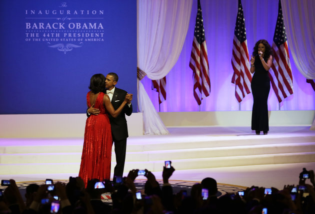 Jennifer Hudson, right, sings while President Barack Obama and first lady Michelle Obama dance at Commander-in-Chief&#39;s Inaugural Ball at the 57th Presidential Inauguration in Washington, Monday, Jan. 21, 2013. (AP Photo/Jacquelyn Martin)
