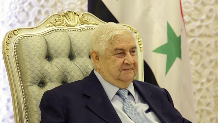 Syrian Foreign Minister Walid al-Moallem meets with his Iraqi counterpart, unseen, in Baghdad, Iraq, Sunday, May 26, 2013. (AP Photo/Hadi Mizban, Pool)