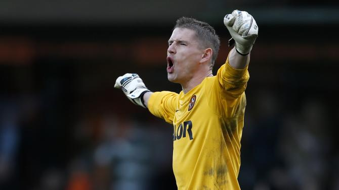Dundee United's Radoslaw Cierzniak celebrates his side's victory over Celtic at the final whistle following their Scottish Premier League soccer match at Tannadice Park Stadium in Dundee