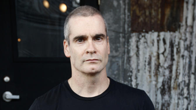 FILE - In this Sept. 10, 2009 file photo, rocker, writer and activist Henry Rollins arrives at the launch of the Sunset Strip Music Festival in West Hollywood, Calif. TakePart TV, a brand-new YouTube channel launching Tuesday, Oct. 2, 2012, will deliver original programming that consists of news, short-form comedy, animation and nonfiction series featuring such names as Henry Rollins, Dan Savage and Kobe Bryant. (AP Photo/Matt Sayles, File)