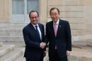 France's President Francois Hollande, left, shakes hand with Secretary General of the United Nations Ban Ki-moon, prior to a meeting at the Elysee Palace, in Paris, Sunday, Nov. 29, 2015. More than 140 world leaders are gathering around Paris for high-stakes climate talks that start Monday, and activists are holding marches and protests around the world to urge them to reach a strong agreement to slow global warming. (AP Photo/Thibault Camus)