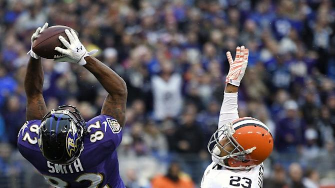 FILE - In this Dec. 28, 2014, file photo, Baltimore Ravens wide receiver Torrey Smith, left, pulls in a catch for a first down in front of Cleveland Browns cornerback Joe Haden in the second half of an NFL football game in Baltimore.When the checkbooks fly open on Tuesday, March 10, 2015, the bidding wars figure to be concentrated on receivers and defensive linemen. (AP Photo/Nick Wass, File)