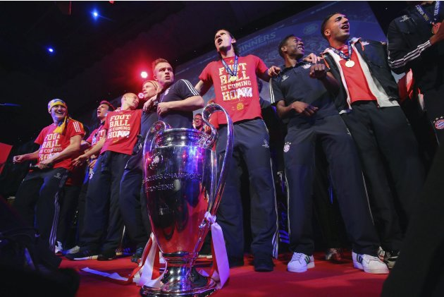 Bayern Munich players celebrate at the team's banquet at Grosvenor House in London