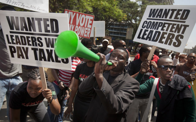 Kenyans demonstrate against their Members of Parliament who last week quietly awarded themselves a $110,000 bonus for five years of service in parliament, in downtown Nairobi, Kenya Tuesday, Oct. 9, 2012. Kenya's 222 legislators currently make about $120,000 a year, one of the highest pay packages in the world when compared to what the lawmakers' constituents make - around $5 a day for the average Kenyan. (AP Photo/Ben Curtis)