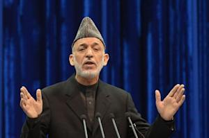 Afghan president Hamid Karzai speaks during the first …