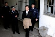 Former Mayor of the Greek northern port city of Thessaloniki, Vassilis Papageorgopoulos is escorted to prison in Thessaloniki on February, 27, 2013. Greece has finally begun to crack down on corrupt politicians but anti-graft experts say much remains to be done to end decades of impunity