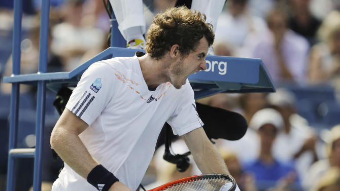 Britain's Andy Murray reacts while playing against Tomas Berdych, of the Czech Republic, during a semifinal match at the 2012 US Open tennis tournament,  Saturday, Sept. 8, 2012, in New York. (AP Photo/Darron Cummings)