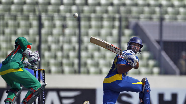 Sri Lanka's Kumar Sangakkara plays a shot during the second one day international (ODI) cricket match against Bangladesh in Dhaka, Bangladesh, Thursday, Feb. 20, 2014. (AP Photo/A.M. Ahad)
