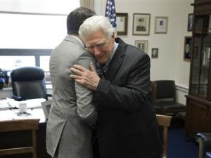 U.S. Representative Moran hugs television reporter after interviews in his office on Capitol Hill in Washington