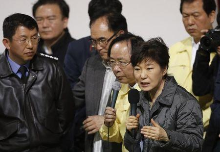 "South Korean President Park speaks to family members of missing passengers who were on South Korean ferry ""Sewol"", which sank at the sea off Jindo, during her visit to a gym where family members gathered, in Jindo"