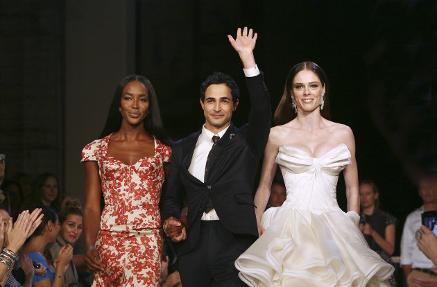 Models Naomi Campbell, left, and Coco, right, walk with designer Zac Posen at the Zac Posen Spring 2013 Runway Show on Sunday, Sept. 9, 2012 in New York. (Photo by Amy Sussman/Invision/AP Images)
