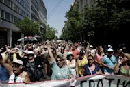 Employees of Greece's ATEbank shout anti-government slogans during a demonstration in Athens on August 3. The Greek economy, struggling in a fifth year of continuous recession, shrank 6.2 percent in the second quarter compared with a year earlier, official data showed on Monday